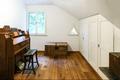 Zimmer im Dachgeschoss - camera da letto nel sottotetto
