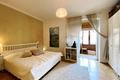 Schlafzimmer mit Zugang auf Veranda - camera da letto con accesso sulla veranda